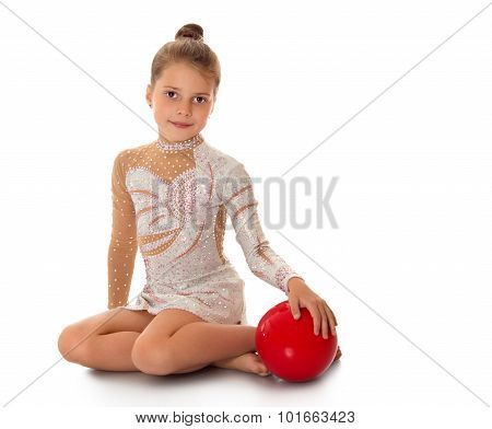 Little gymnast with the ball