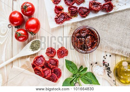 Dried Tomatoes In An Envelope Of Kraft Paper On A Wooden Table Covering Of Sackcloth.  Top View