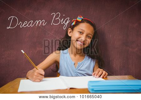 The word dream big and pupil at her desk against desk
