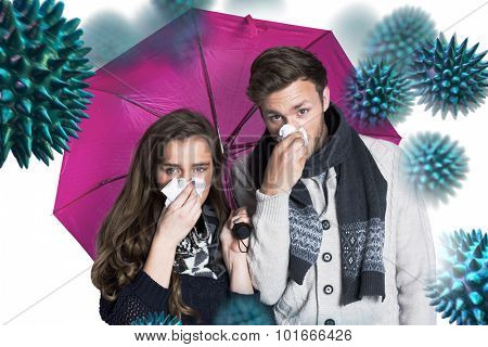 Couple blowing nose while holding umbrella against virus
