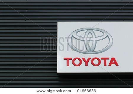 Toyota logo on a facade of a dealer