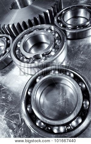 ball-bearings and gears, aerospace titanium and steel parts, blue metal toning concept