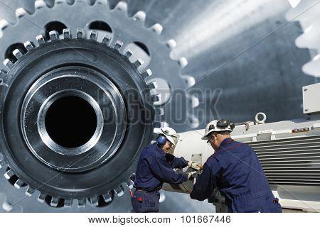 mechanics, workers with giant cogwheels axle machinery