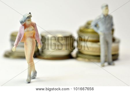Miniature People With Coins