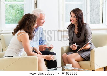 Advisor giving investment and retirement advice to senior woman and man