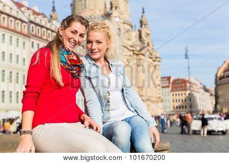 Friends at Dresden Frauenkirche strolling around as tourists