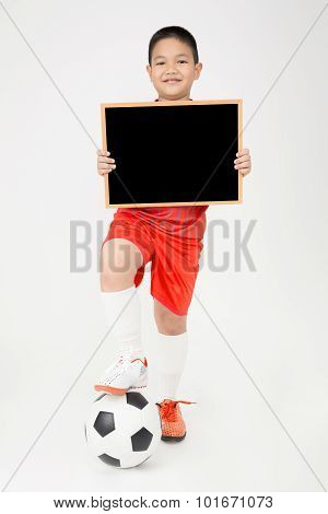 Little Asian Boy Holding Empty Wood Blackboard In Sport Uniform