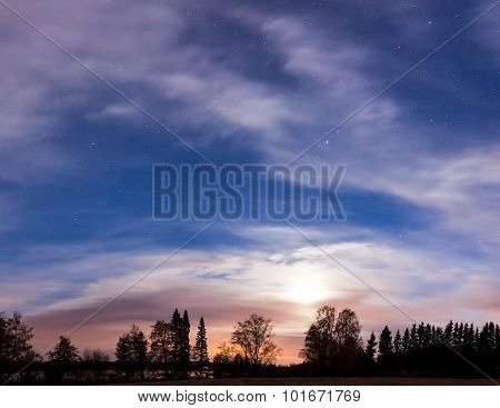 Night landscape and cloudy starry sky panorama