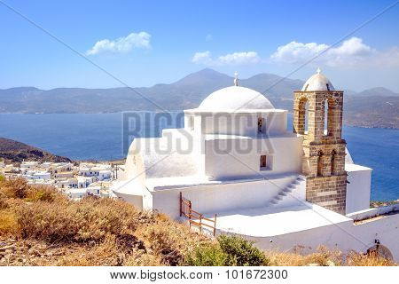 Scenic View Of Traditional Greek Cycladic Church, Village And Sea