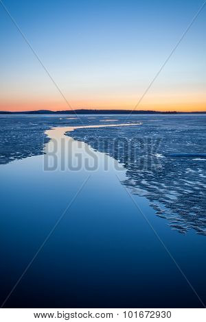 Serene frozen lake scape at twilight