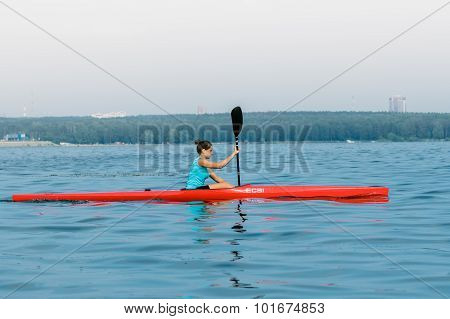 Girl athlete in a kayak