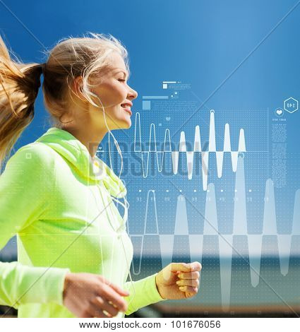 sport, fitness, exercise and lifestyle concept - smiling woman doing running with earphones outdoors