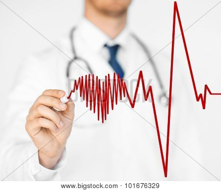 close up of doctor drawing electrocardiogram on virtual screen