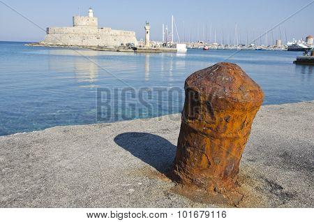 Rusty Historical Bollard In Greek Island