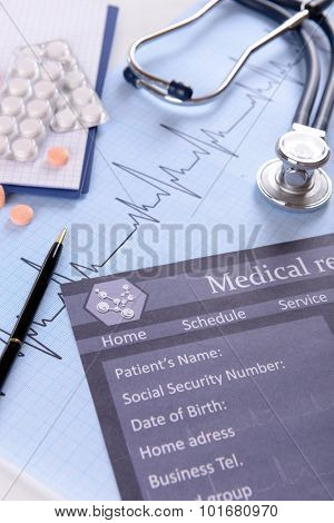 Stethoscope on cardiogram  sheet, closeup