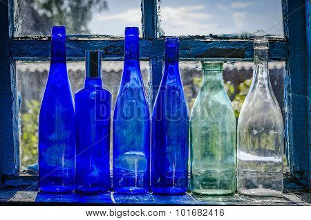 empty bottles on the old window