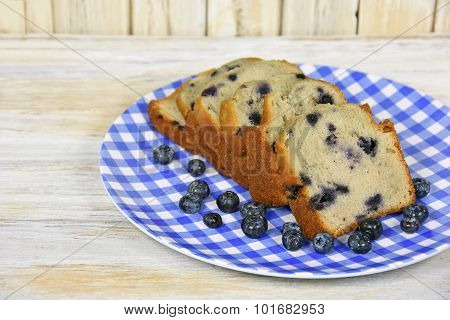 blueberry bread on checked plate