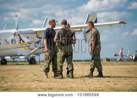 UKRAINE, KHARKIV -AUGUST 24: pilots on aerodrome near airplane at Kharkiv on Ukraine Independence Day  in Kharkiv on August 24, 2015