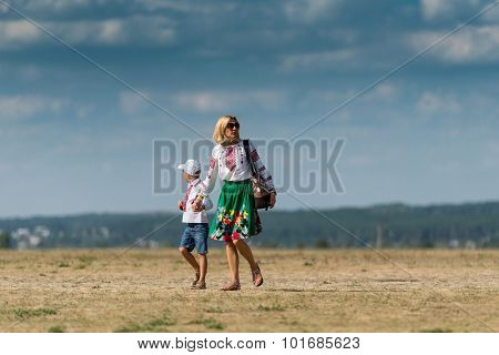 UKRAINE, KHARKIV -AUGUST 24: mother and son on aerodrome at Kharkiv on Ukraine Independence Day     in Kharkiv on August 24, 2015