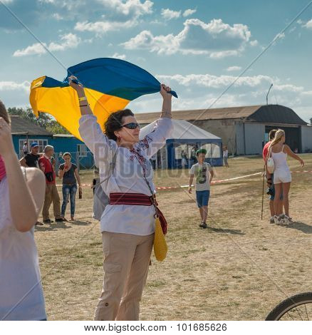 UKRAINE, KHARKIV -AUGUST 24: people watching airshow on Kharkiv aerodrome on Ukraine Independence Day  in Kharkiv on August 24, 2015