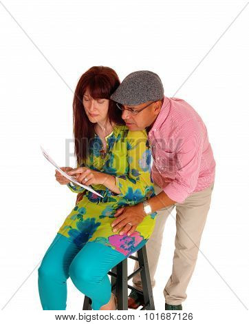 Couple Looking At There Tablet Computer.