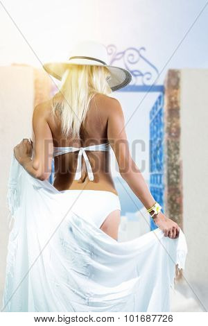 Young woman enjoying the view of Santorini island Greece