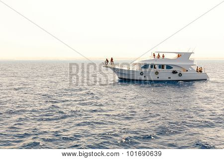 White yacht in the blue tropical sea