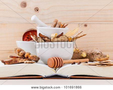 Alternative Medicinal , Chinese Herbal Medicine  For Healthy Recipe With Dry Herbs  And Mortar On Wo