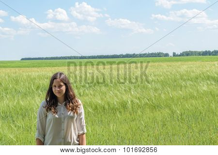 Young Girl In Green Field