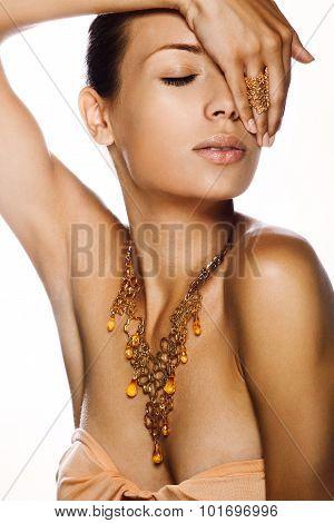 Portrait of a beautiful woman. Jewelry make-up.