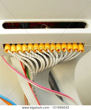Electric stranded white wires connected to the commutators