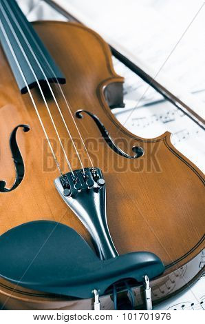 Old violin lying on the sheet of music music concept. ** Note: Shallow depth of field
