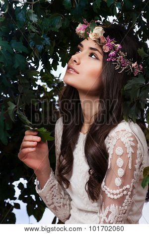 Beautiful yound Girl with flowers in her hair