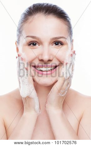 Beautiful Woman Washing Her Face - Isolated On White