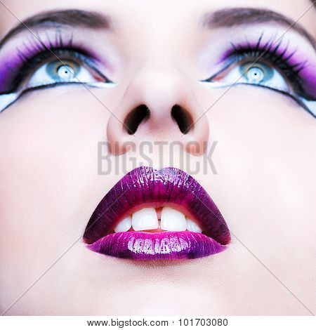 Beauty Makeup. Purple Make-up And Colorful Lips. Beautiful Girl Close-up Portrait
