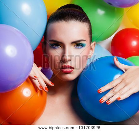Beauty Girl Portrait With Colorful Makeup, Nail Polish And Accessories. Colourful Studio Shot Of Fun