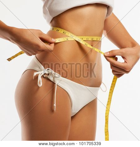 Woman Measuring Her Waistline . Perfect Slim Body