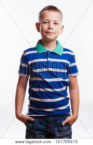Young Pretty Boy Posing At Studio As A Fashion Model. Photo Of Preschooler 7 Years Old Over White Ba