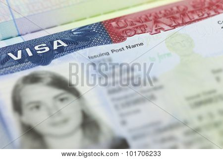 The American Visa in a passport page (USA) background - selective focus