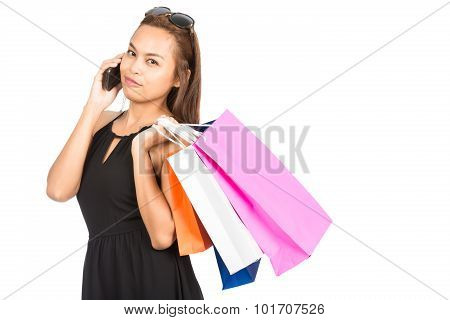 Asian Female Shopper Cell Phone Shopping Bags At