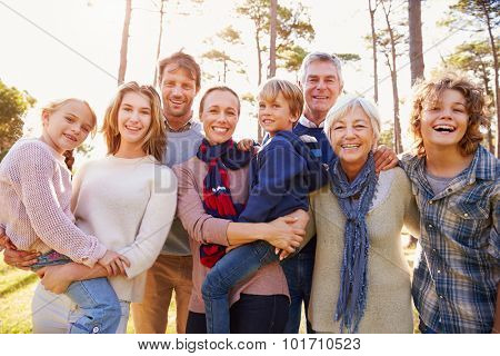 Happy multi-generation family portrait in the countryside