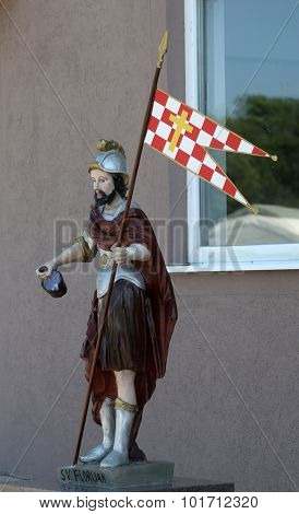PETINA, CROATIA - JUNE 10: The statue of St. Florian patron of firefighters in front of the fire department Kosnica in Petina, Croatia on June 10, 2015.