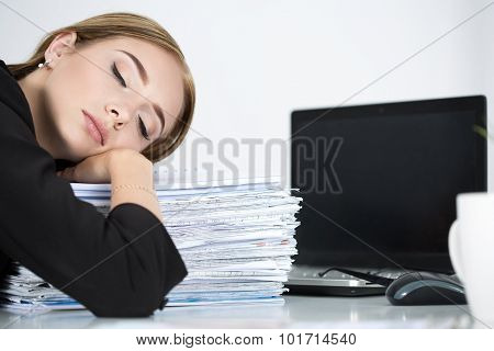 Tired Business Woman Slleeping On Heap Of Papers At Her Working Place