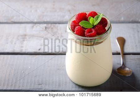Healthy breakfast - fresh Greek yogurt with raspberries and mint
