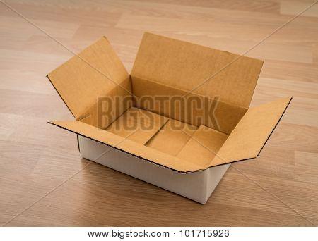 Cardboard box on wood