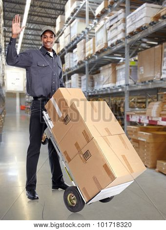African American delivery man in a storehouse.