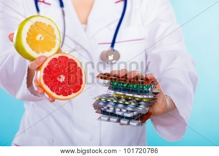 Doctor Offering Chemical And Natural Vitamins.
