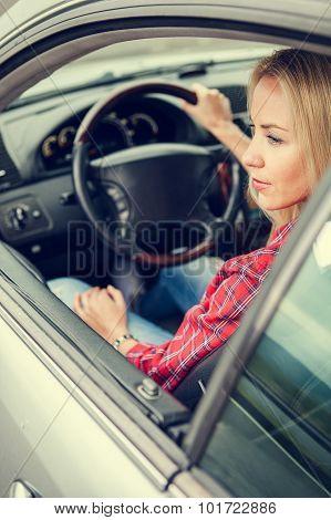 Beautiful Young Woman Sitting In Car