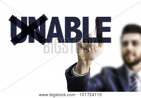Business man pointing the text: Unable/Able
