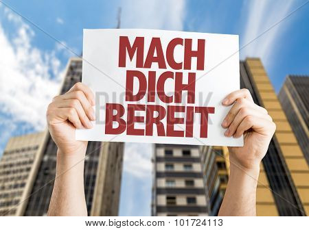Get Ready (in German) placard with cityscape background